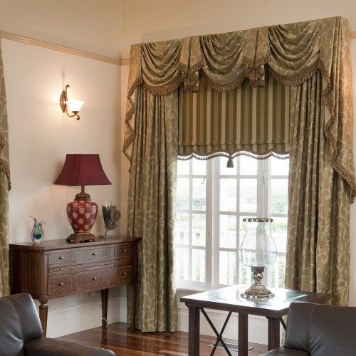 Drapes with Matching Swag & Tails paired with a Bonded Roller Blind by O'Gormans