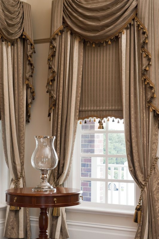 Drapes with custom made Swag and Tails and a matching bonded Roller Blind by O'Gormans