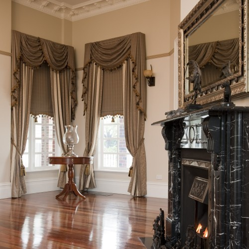 Custom Drapes with Swag & Tails paired with Traditional Bonded Roller Blinds by O'Gormans