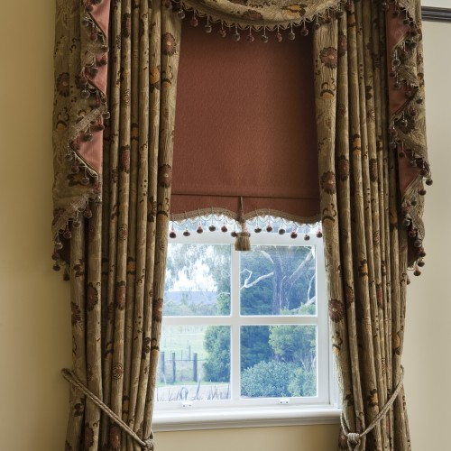Custom Drapes with Swag & Tails paired with a Bonded Roller blind by O'Gormans