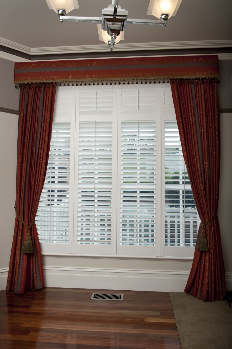 Plantation Shutters with Drapes and a Pelmet