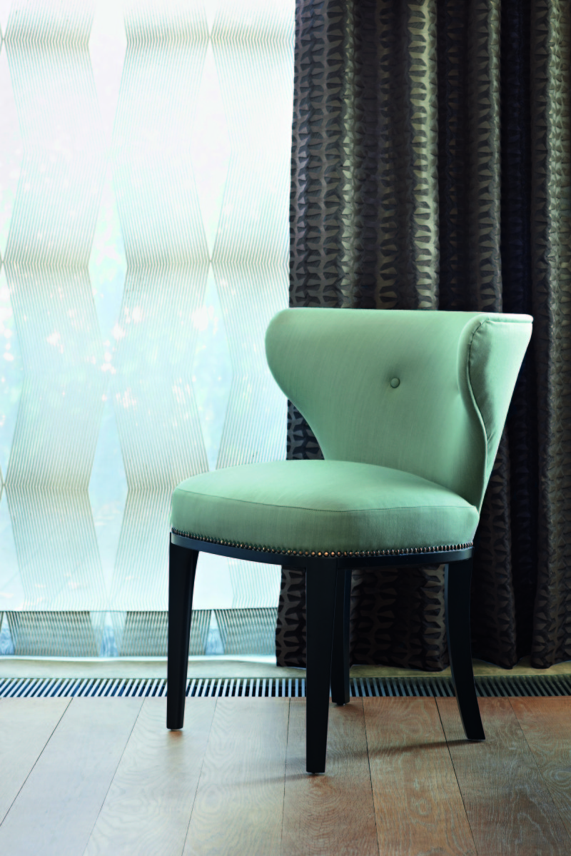 Upholstered Chair with Sheer curtains and Drapes