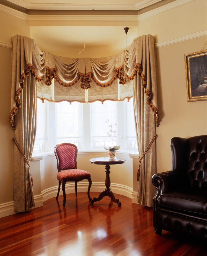 Drapes Tied Back With Matching Swag & Tails & Roller Blinds